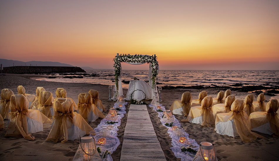 Wedding at the beach with beautiful sunset